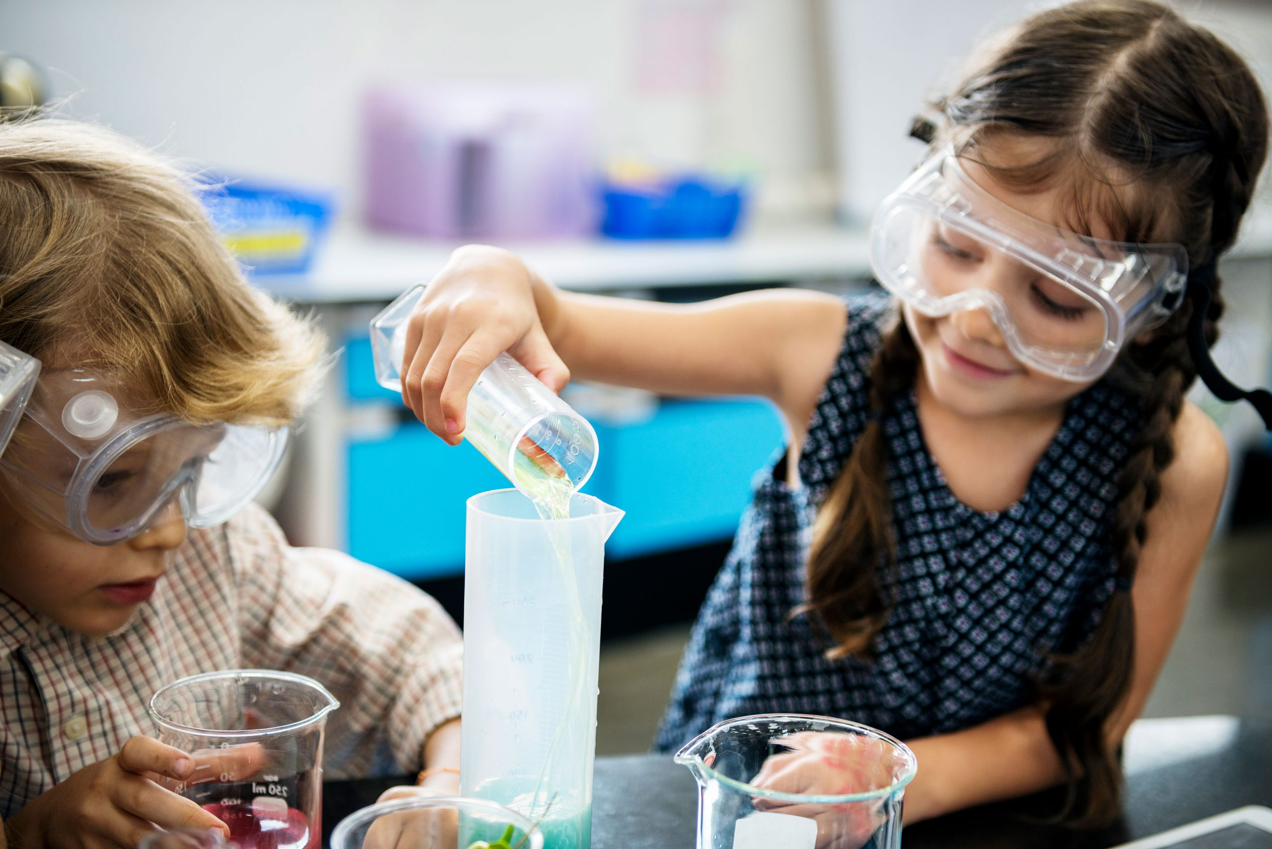 young girl and boy in lab